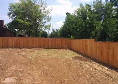 concrete pad and privacy fence by gorilla brothers